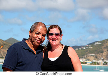 Interracial couple on cruise vacation.
