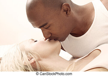 Interracial couple kissing