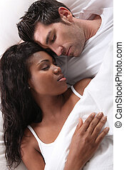 interracial couple sleeping