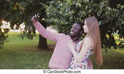 interracial couple take selfie