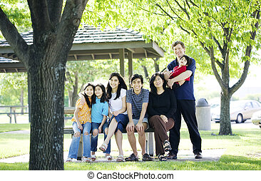 Family sitting together on picnic bench outdoors