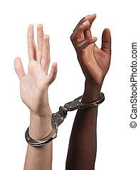 interracial handcuffed - Caucasian man and African American...