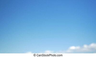 Interracial handshake on sky background