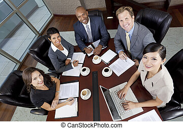 Interracial Men & Women Business Team Meeting in Boardroom -...