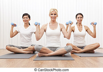 Interracial Yoga Group of Three Women Weight Training