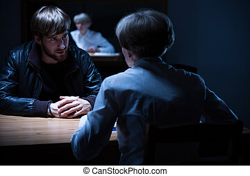 Interrogation in a dark room - Picture of police...