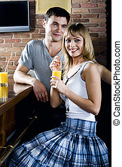 Interrupted conversation - Smiling cute blond woman and...