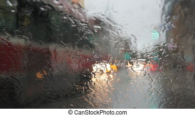 Intersection & rainy windshield. - View of intersection...