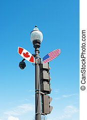 Intersection street sign with direction to Canada or United stat