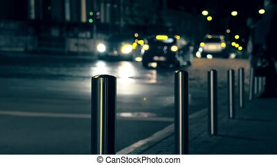 Intersection with cars at night. City life.
