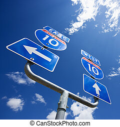 Highway interstate 10 sign with arrows showing direction.