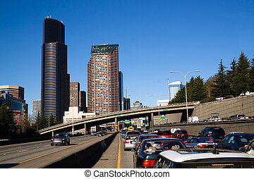 Interstate 5 Highway Cuts Downtown Seattle Skyline During Rush