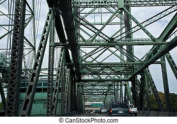 Interstate Bridge is a pair of nearly identical steel vertical lift, through truss bridges that carry Interstate 5 traffic over the Columbia River between Vancouver, Washington, and Portland, Oregon,