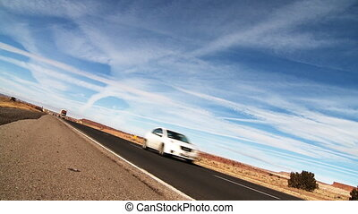 """Low """"dutch"""" angle on a semi truck passing camera along US Interstate 40 (I-40) about 30 miles West of Albuquerque, New Mexico."""