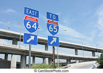 Signs for interstate highways I-64 and I-65 in Louisville, Kentucky. Symbolizes transportation, infrastructure, and travel.