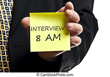 Interview 8 am reminder in business man hand