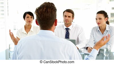 Interview panel listening to applicant and speaking in the...