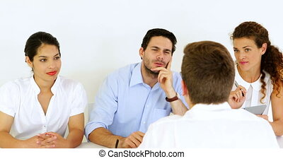 Interview panel listening to job applicant in the office