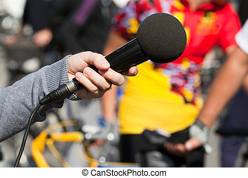 interview - A journalist is making a interview with a...