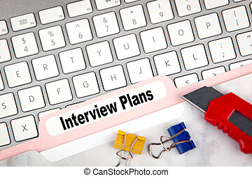 interview plans concept. Folder Register on a white computer keyboard