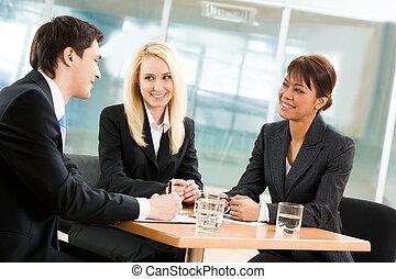 Interview - Portrait of friendly business team sitting ...