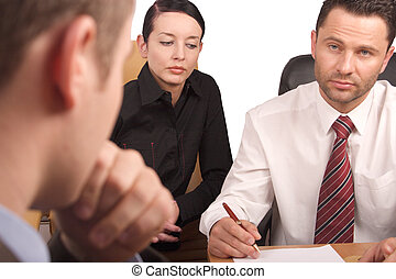 Three persons business meeting -isolated, thinking man out of focus