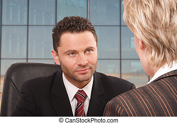 interview - White business man and woman talking in the ...