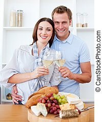 Intimate couple drinking wine while cooking