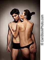 Intimate Couple In Lingerie, standing topless woman with...