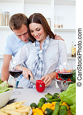 Intimate couple preparing dinner