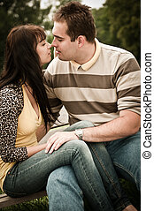 Intimate moments - couple kissing outdoors