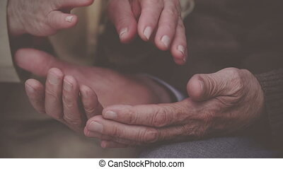 Intimate Support - Extreme close up of elderly hands holding