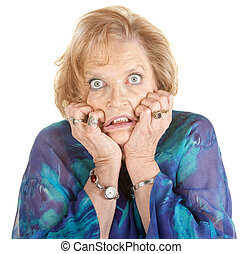 Intimidated Woman - Intimidated older female with wide eyes...