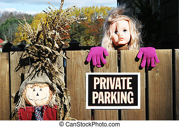 Intimidating private parking sign