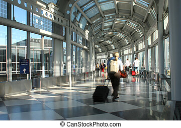 Intl airport - Busy people rushing through an airport