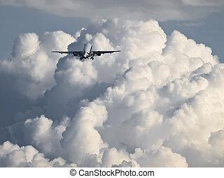 Into The Clouds - Civil aircraft climbing into large nimbus ...