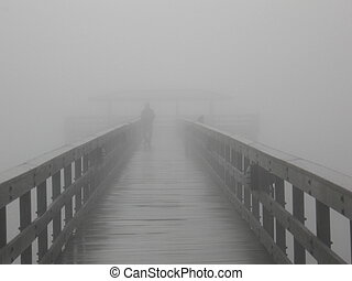 Into The Fog - A person disappearing into the fog on a pier...