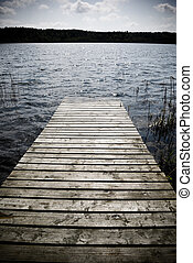 Into the water. - Weathered wooden pier - intentional ...
