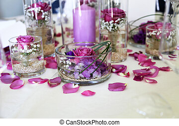 intricate flower arrangement centerpiece of purple flowers and petals