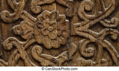 Intricate flower pattern on carved wood surface - A still,...