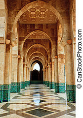 Intricate marble and mosaic archway outside mosque -...