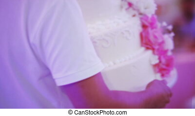 Introduction wedding cake - Waiter brings wedding cake and...