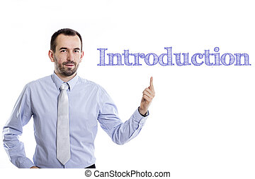 Introduction - Young businessman with small beard pointing up in blue shirt