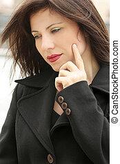Introspection - Woman quietly ponders