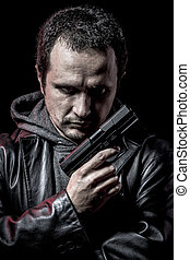 Intruder, thief, armed man with black leather jacket,...