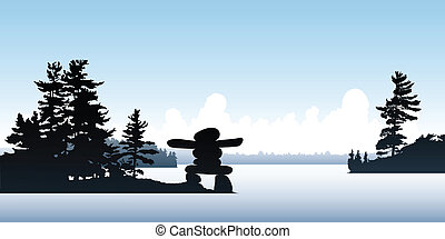 Inukshuk Point - An Inukshuk on a point on a northern lake.