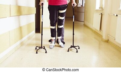 Invalid in orthosis walking with support of two walking cane