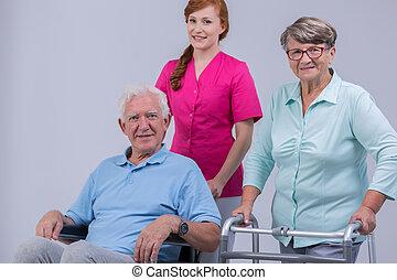 invalide, senior koppel, carer