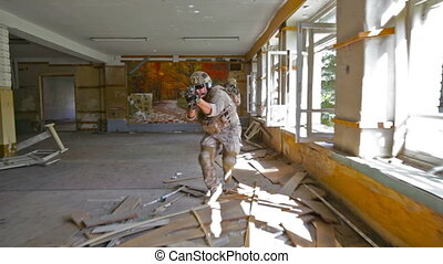 Invasion - Troops breaking into a derelict building during...