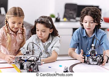 Inventive children testing technologies at school